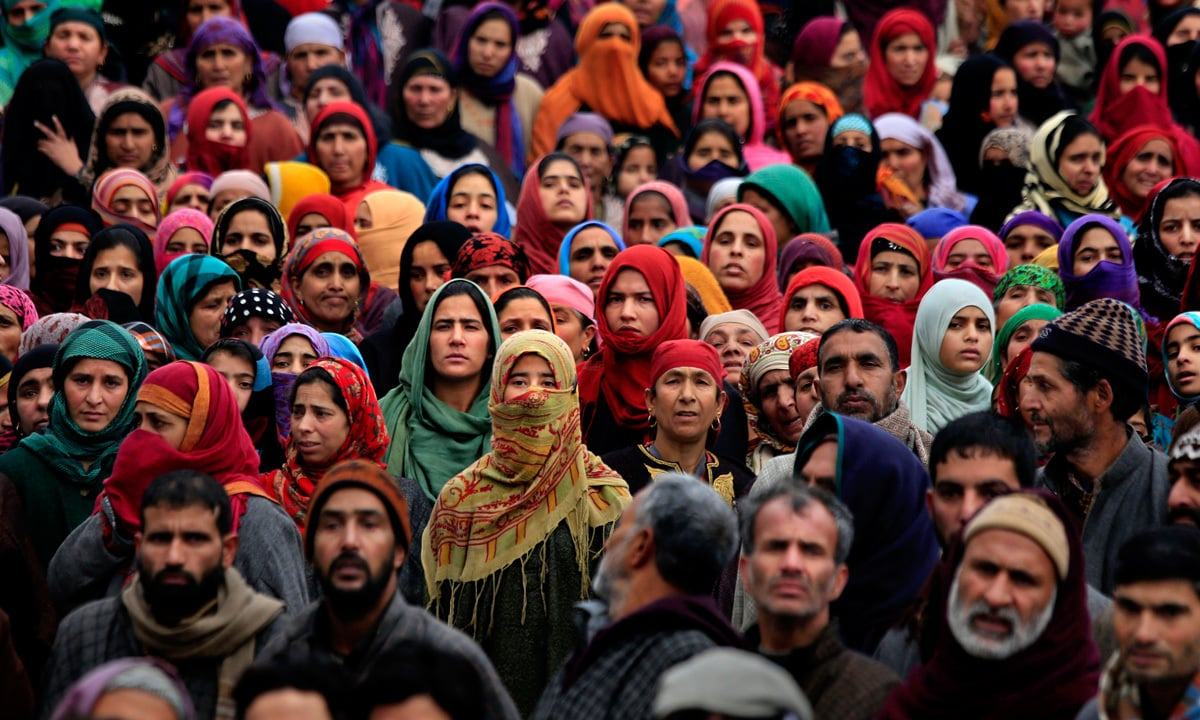 Kashmiris watch the funeral procession of a local militant freedom fighter. Image:    DAWN