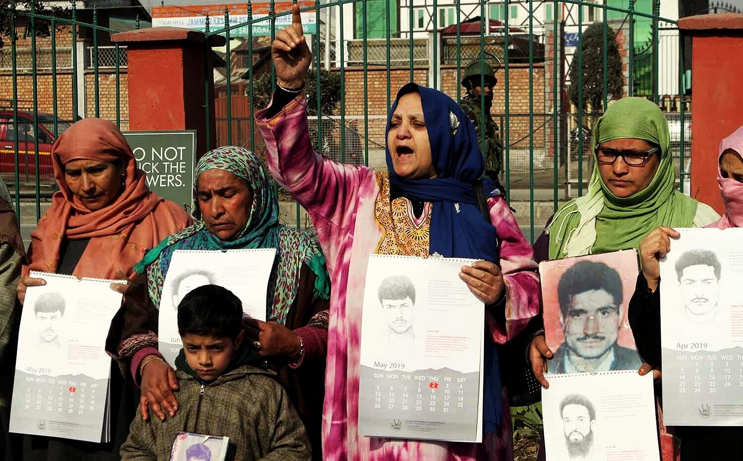 Parveena Ahangar, Chairman of Association of Parents of Disappeared Persons  ( APDP) leading a protest against enforced disappearances of Kashmiris by the Indian forces.    Free Press Kashmir