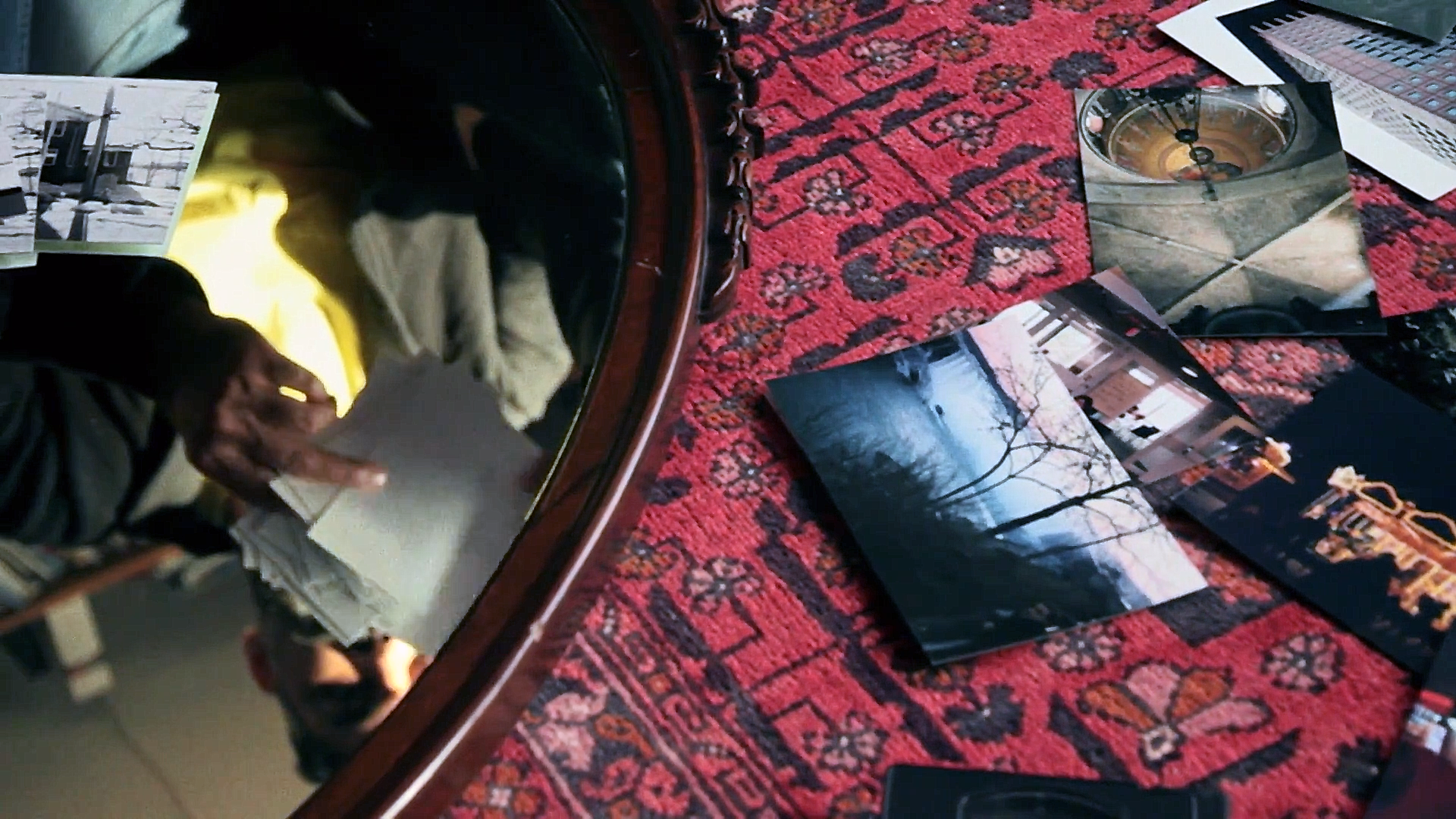 A still from Abu: Arshad looks through photographs of different moments in his life. Source:    Film Trailer, IMDb
