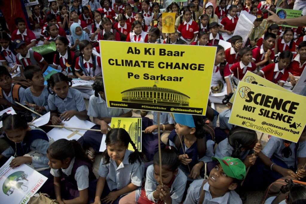 "Indian students in Hyderabad participate in the March 2019 Climate Protest, holding placards that say ""Ab ki baar Climate Change pe Sarkar"" (This parliamentary election we shall vote based on climate change policies). Image:    AP Photo/Mahesh Kumar A."