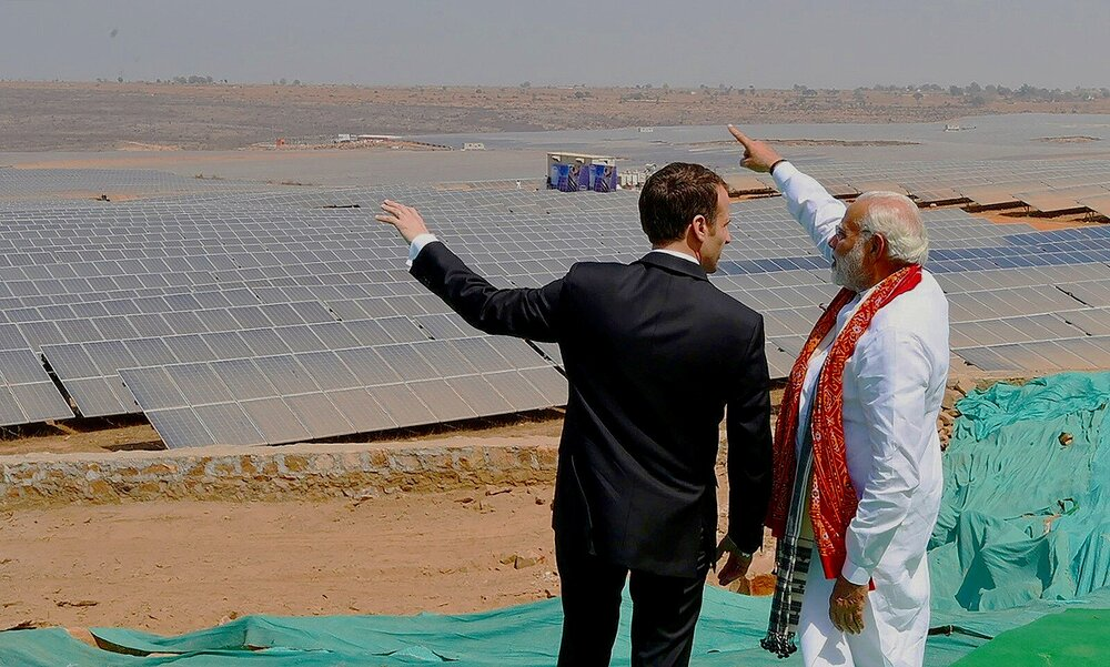 "Indian Prime Minister Narendra Modi, hosts French President Emmanuel Macron at the opening of a new solar power ""park"" in Mirzapur village in Uttar Pradesh, Image:    Ludovic Marin/AFP via Inside Climate News"