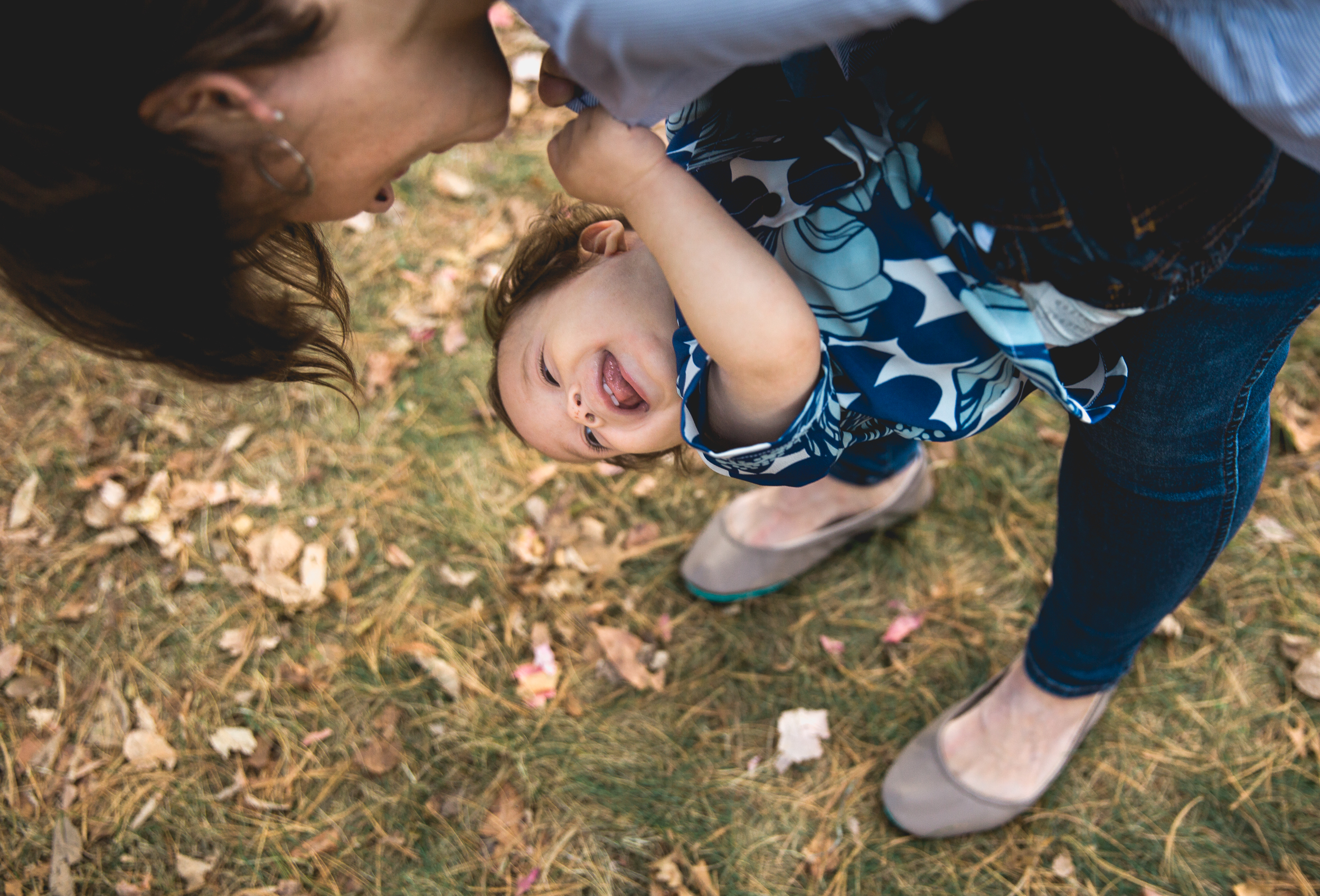 Greater Boston family photographer Joy Uyeno Sudbury toddler upside down with mom