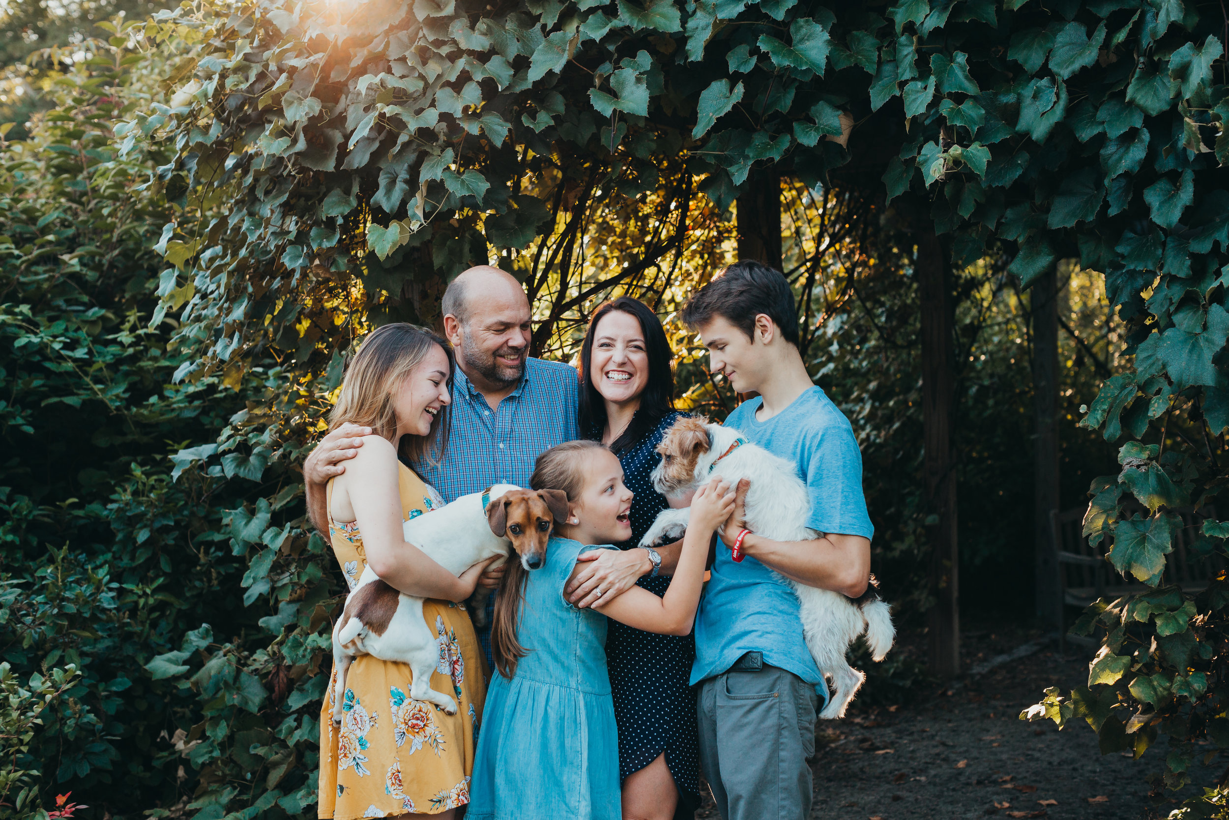 Family of five with two dogs at Acton Arboretum