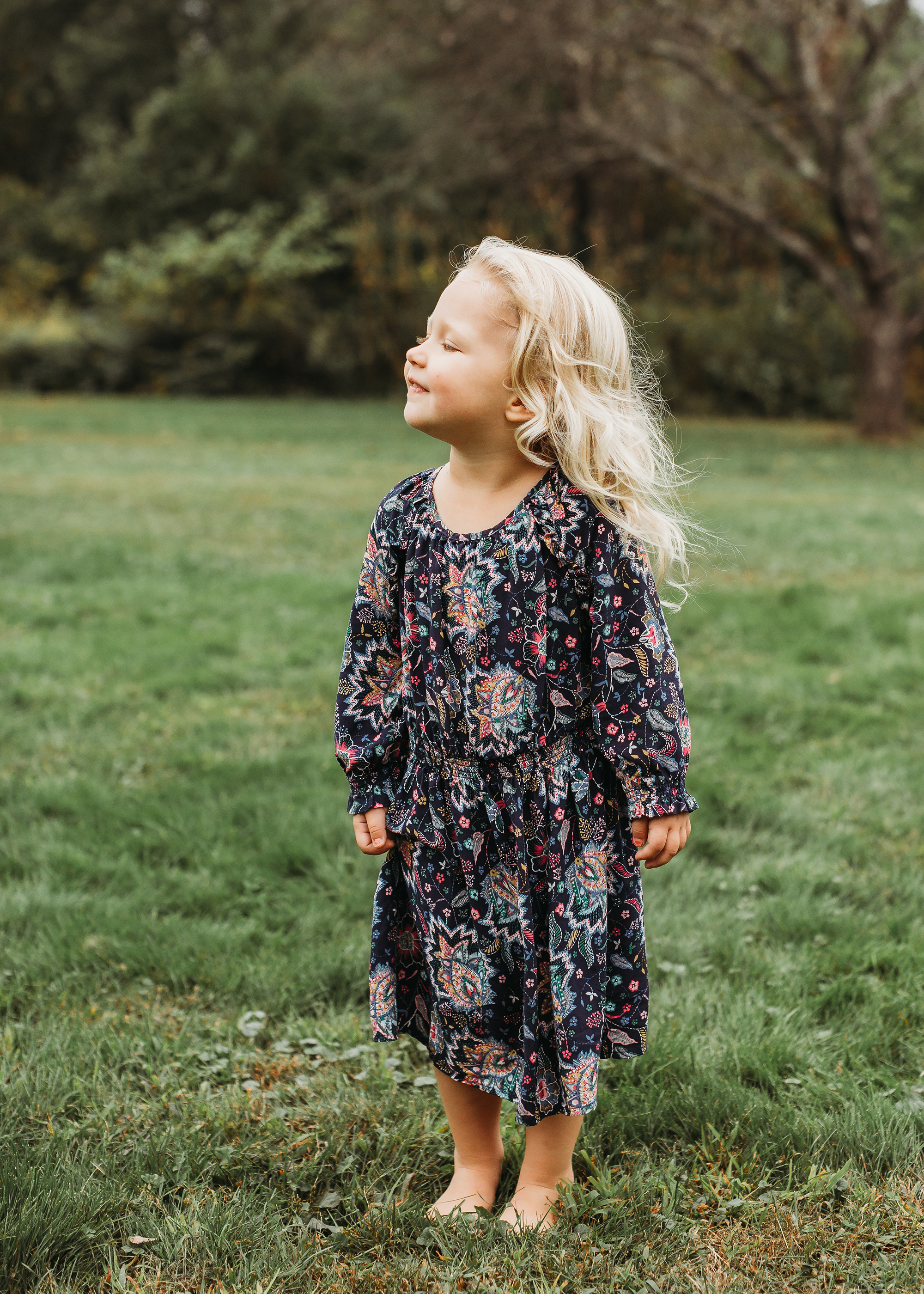 Toddler girl in boho dress for Sudbury family portraits. Boston family photographer, natural light, candid.