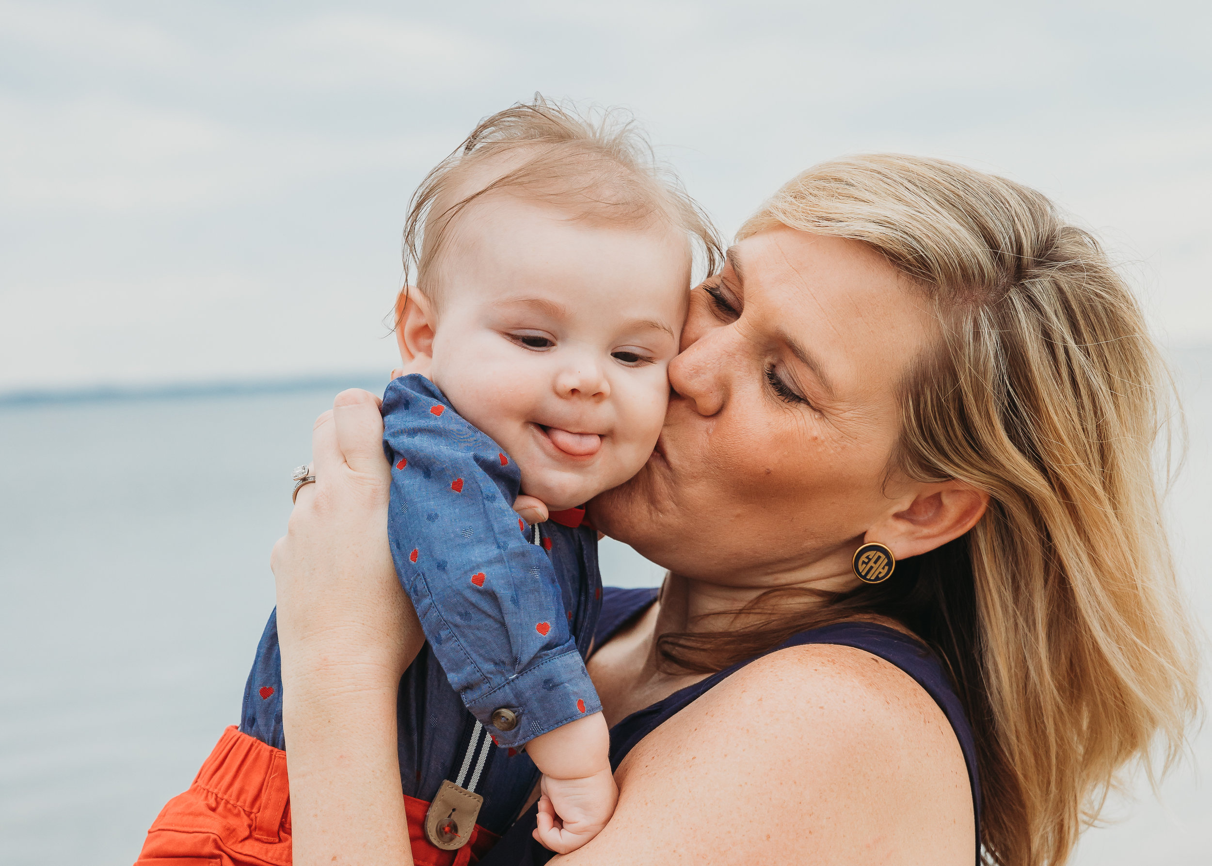 Mama kissing 5-month-old baby in bowtie. Boston family photographer. Beach family photos.
