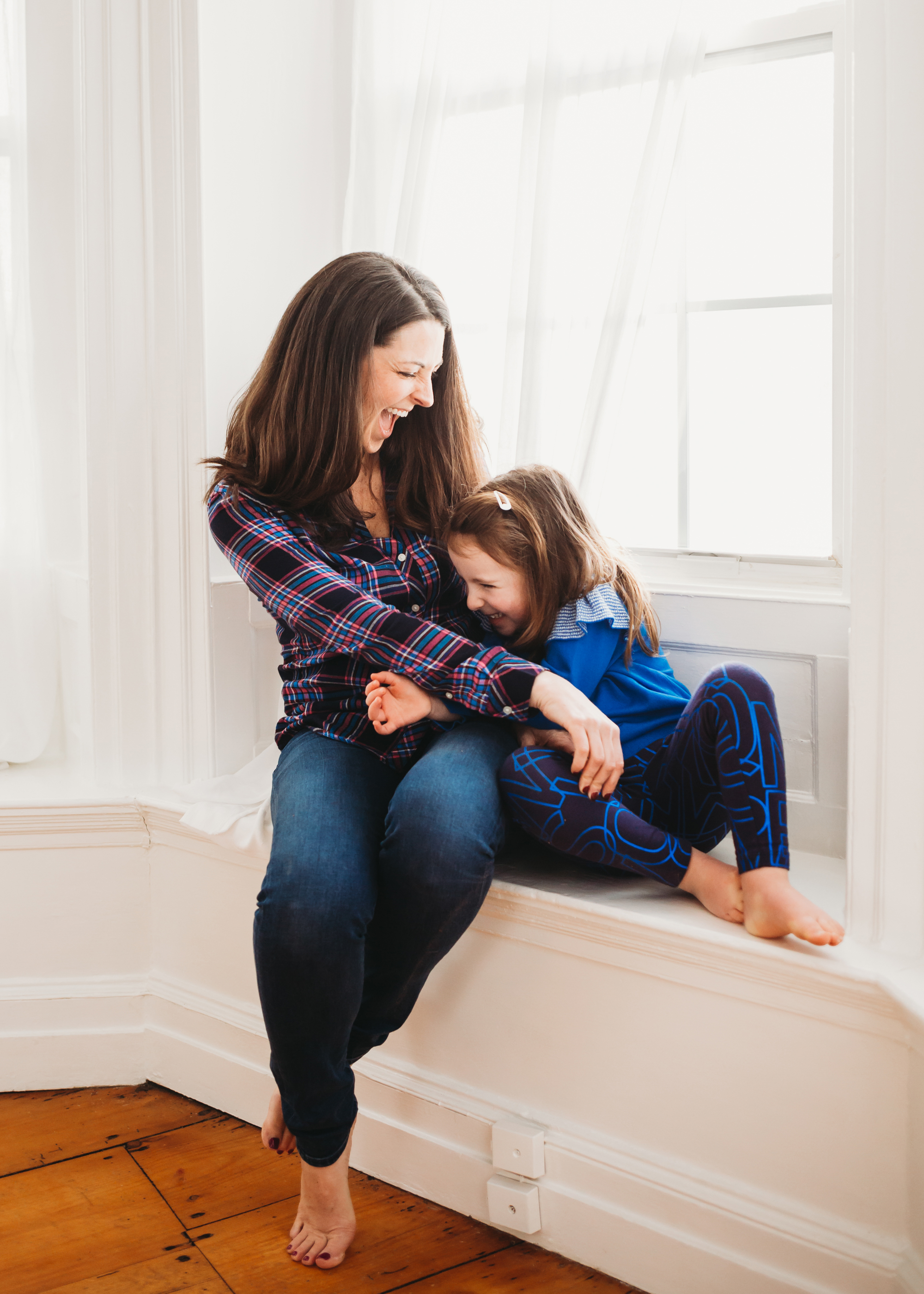 Mommy and me photos while little brother has a snack. Natural light family portraits Boston.
