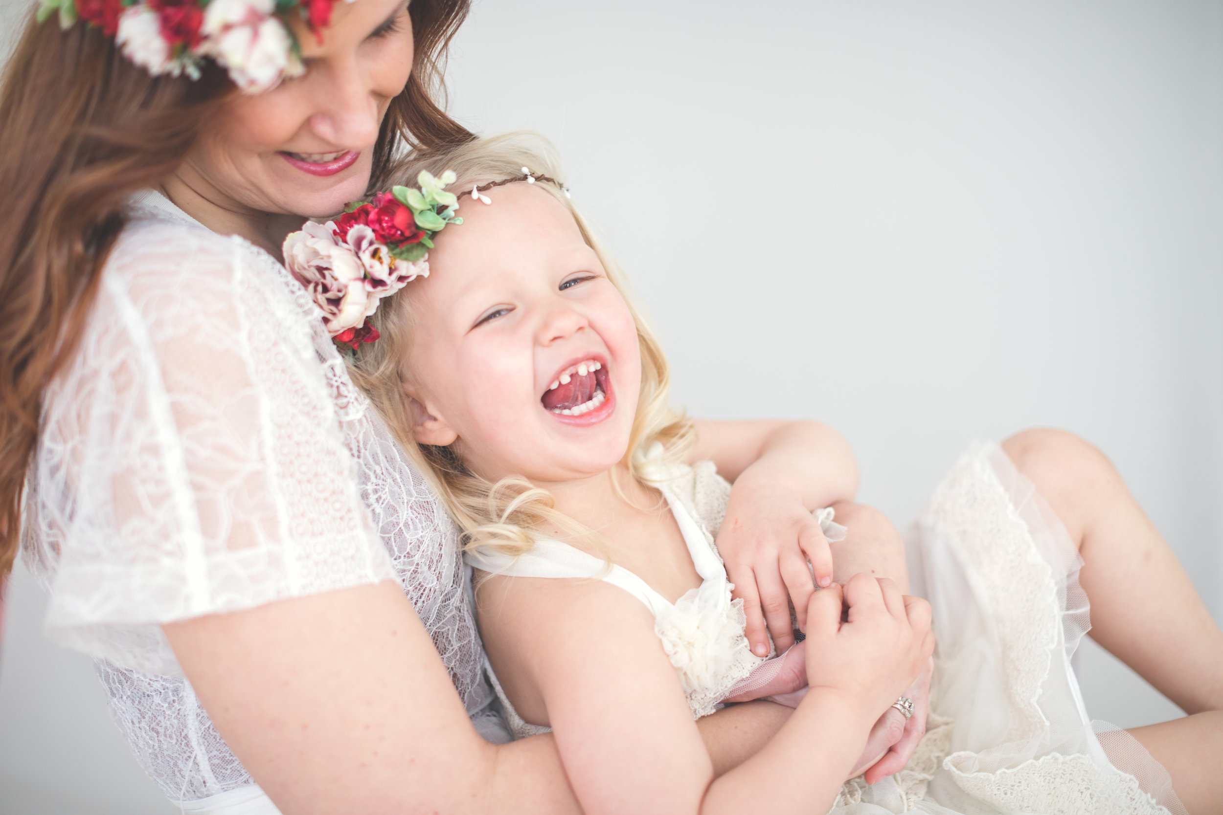 Flower crown sessions for Mother's Day. Motherhood photos. Mother daughter portrait session.