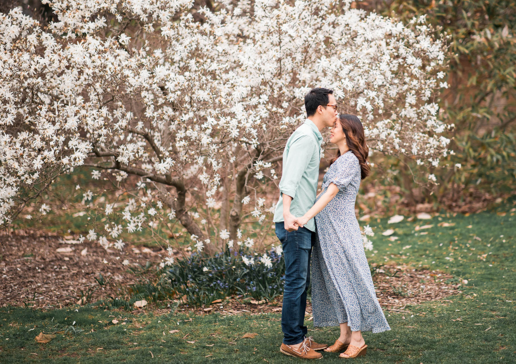 A photo of just the happy couple under this beautiful dogwood tree at the Arnold Arboretum.