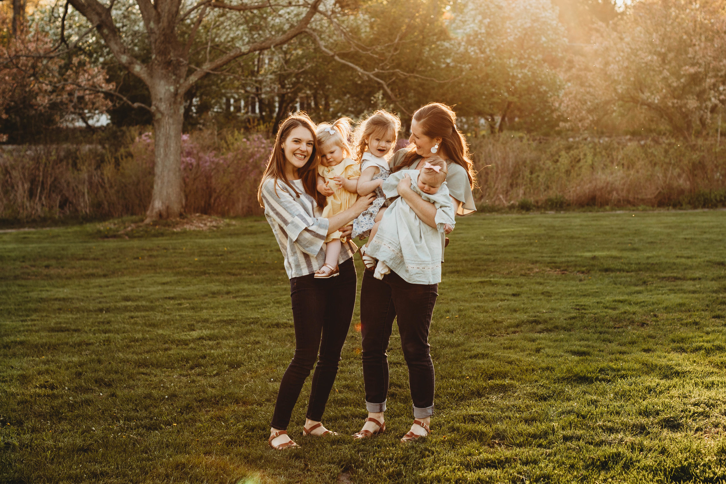 Three girl cousins and their moms at Acton Arboretum. Springtime golden hour session. Boston family portraits with Joy LeDuc.