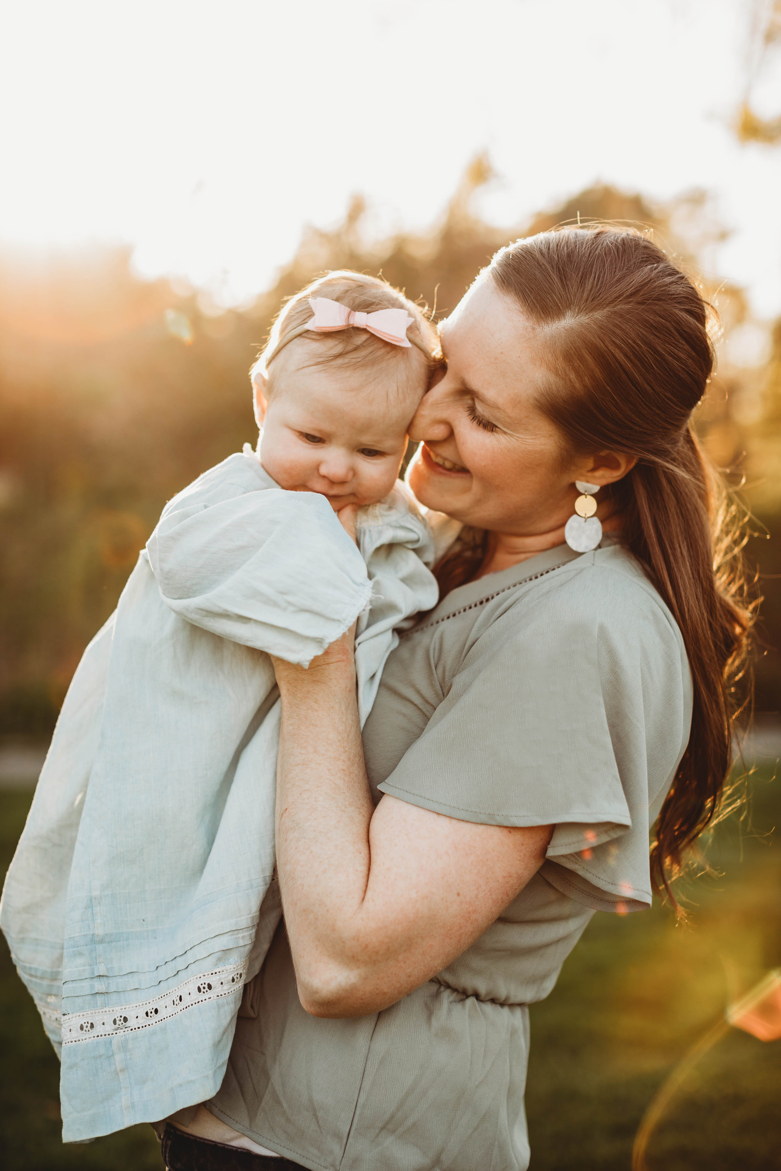 Putting babies in antique hand-me-downs from older generations is a beautiful way to incorporate family history into portraits. Acton Arboretum golden hour family portraits. Boston family photographer Joy LeDuc.