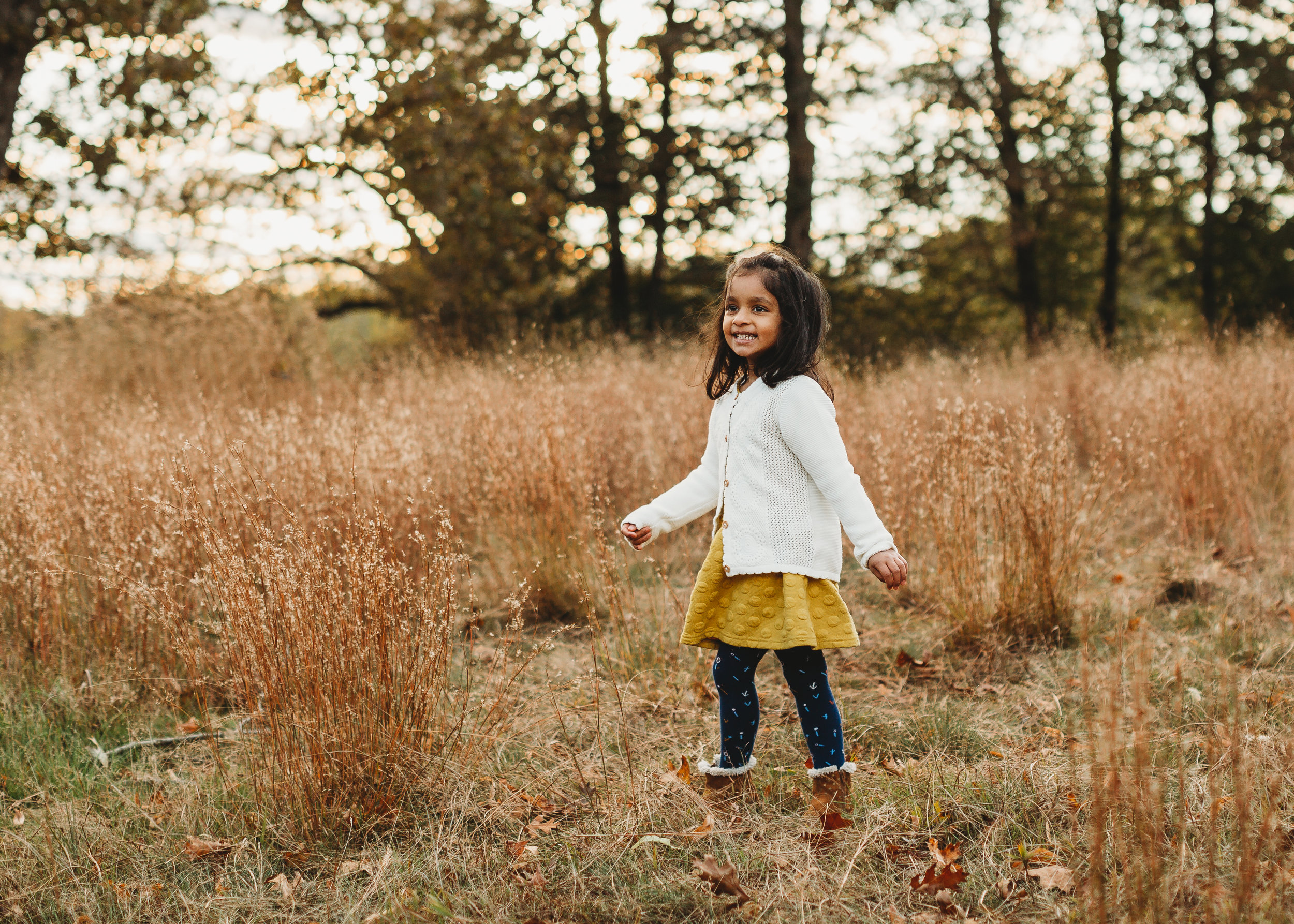 Movement helps children to stay happy and engaged during family photo sessions. Concord, Massachusetts golden hour photography. Boston family portraits.