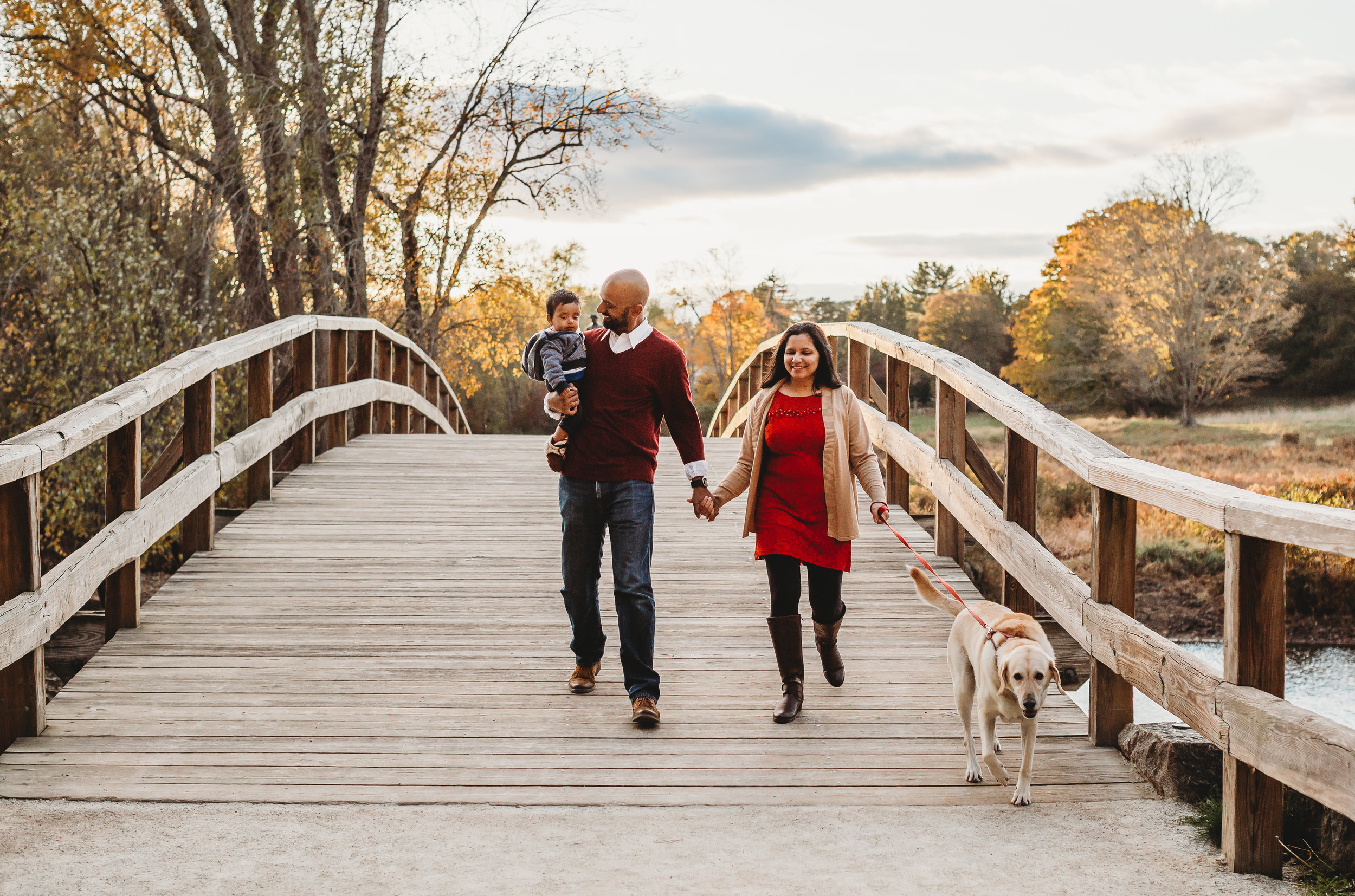 It's not just kids who look better with movement! Parents look more comfortable and natural with walking and moving prompts as well. Old North Bridge, Concord, Massachusetts. Organic, candid lifestyle photography for families in Greater Boston.