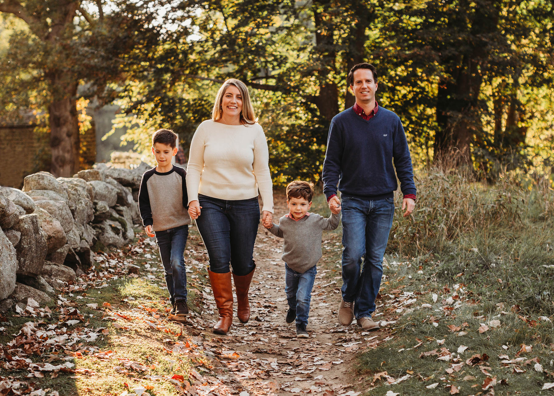 Choosing a location for fall family photos in Greater Boston. In the fall, the foliage can be unpredictable! If you can be flexible, I'll let you know where the foliage is the most vibrant as we get closer to your session. Concord, Massachusetts family portraits in the fall.