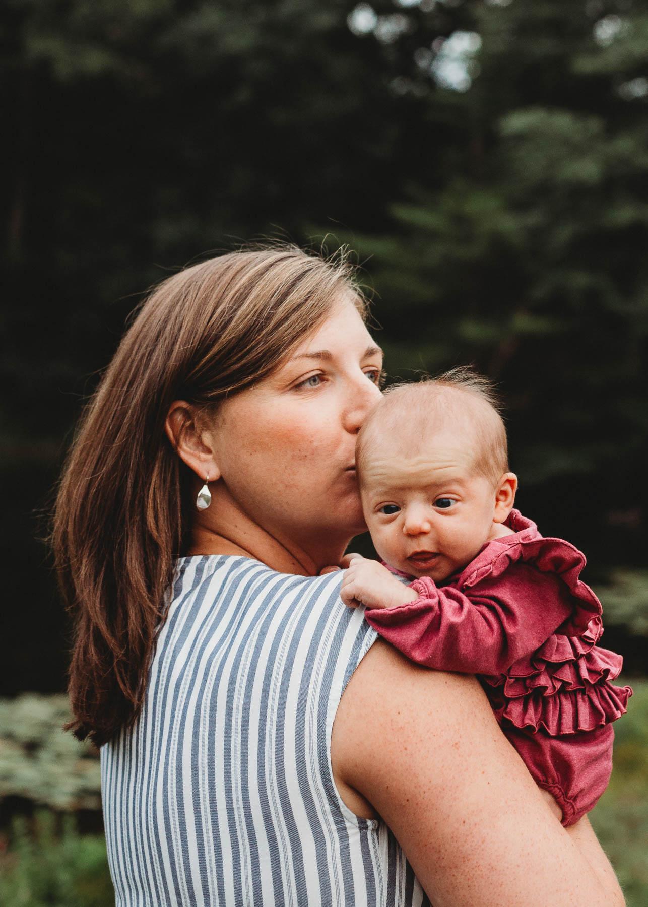 Sweet moments with Sudbury, Massachusetts family's newborn photo session. Indoor and outdoor session in Greater Boston. Boston family photographer Joy LeDuc.