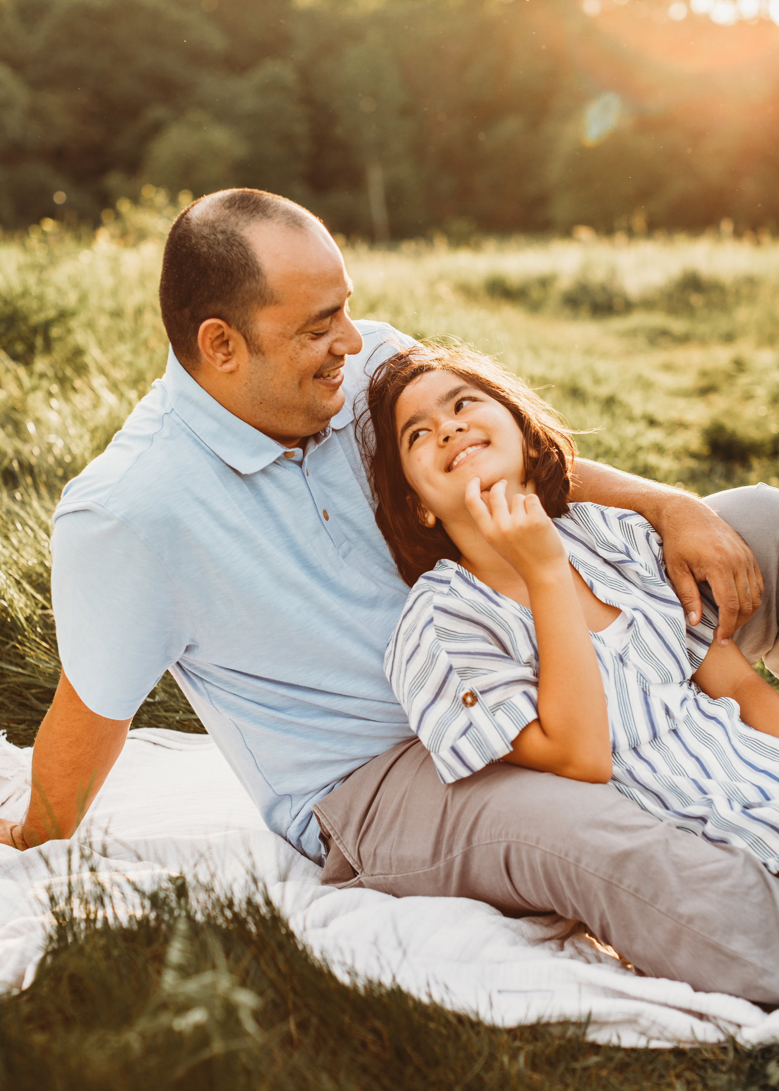 Sweet moment between dad and tween daughter. Boston family photography. Natural light lifestyle photographer. Golden hour family portraits.