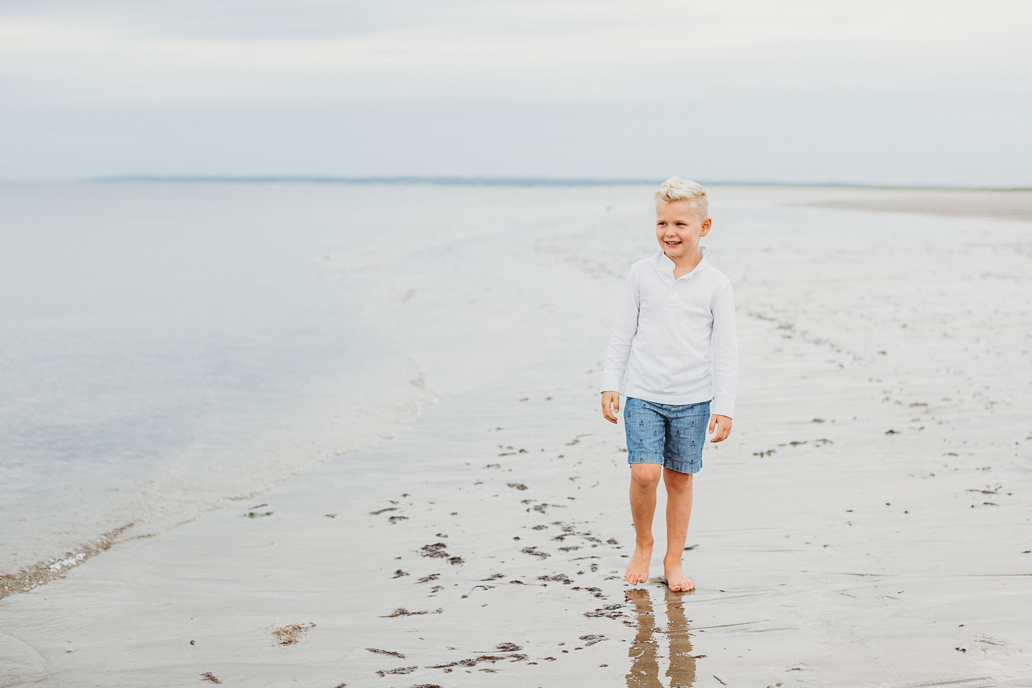 The biggest benefit to cloudy days? We can photograph your family in any direction, because the clouds create a giant diffuser for clean, soft light. This Wellesley, Massachusetts family had gorgeous, clean light on their cloudy beach day session.