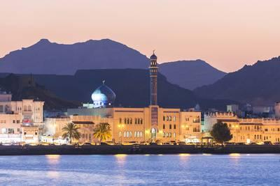 matteo-colombo-oman-muscat-mutrah-harbour-and-old-town-at-dusk_u-L-PXTB5Y0.jpg
