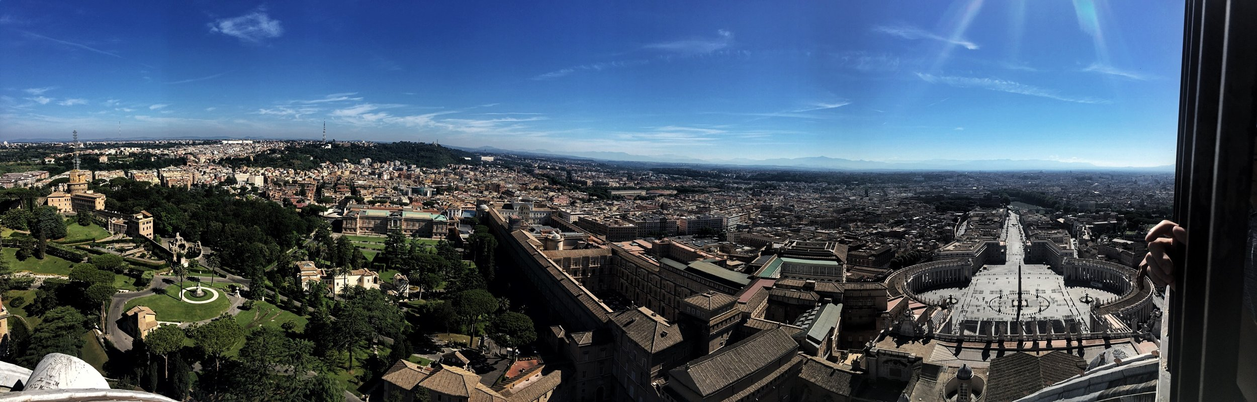 A panorama shot taken by Naomi – Vatican museum in the center, the square on the right.