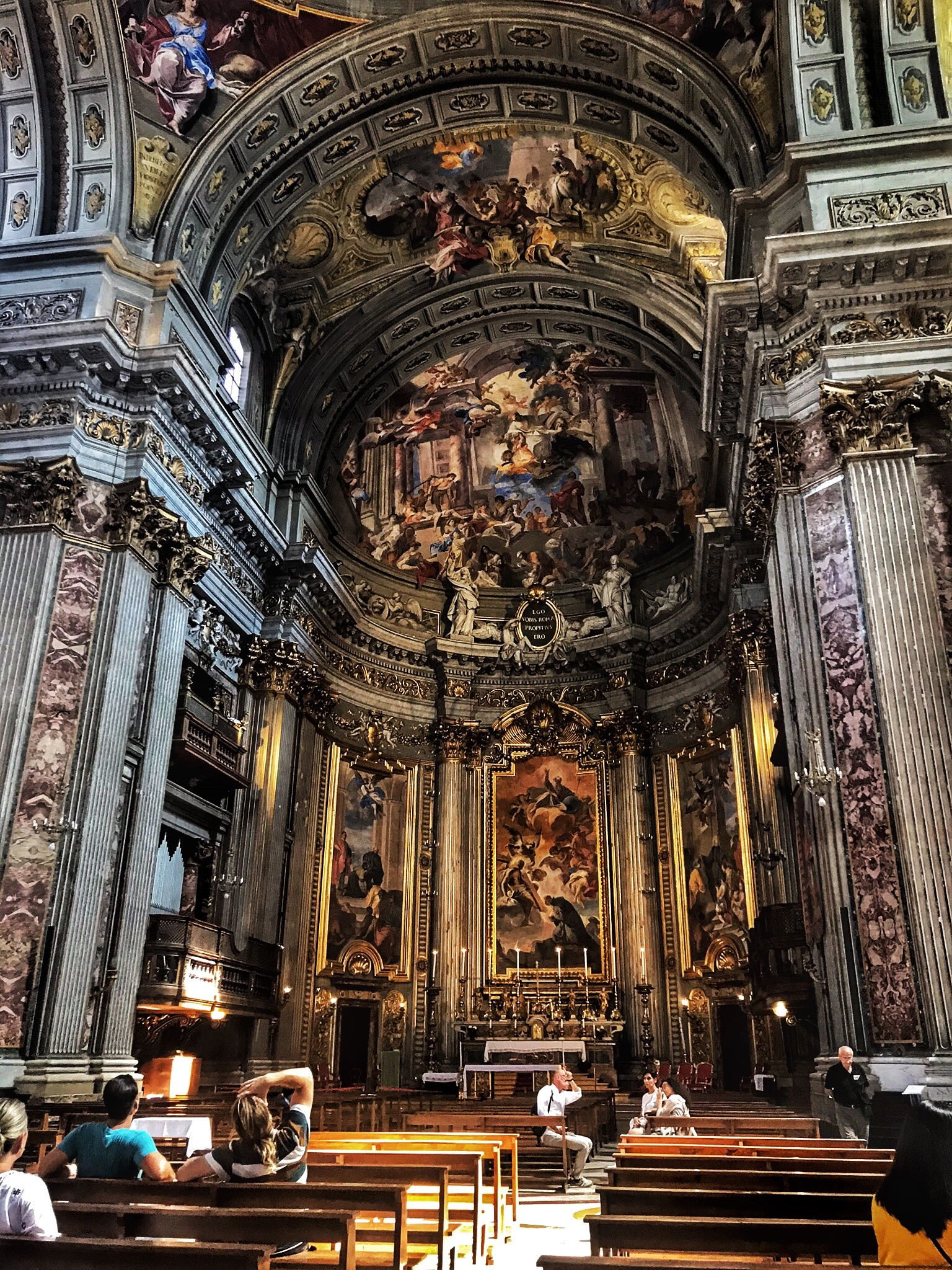 The inside of stone churches in Rome are very cool even on a hot day. Karol and Keane have never before been so religious.