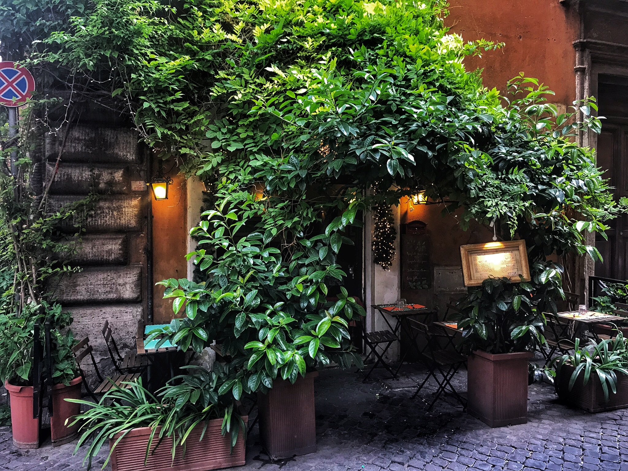 A charming little cafe on a charming little street in Rome.