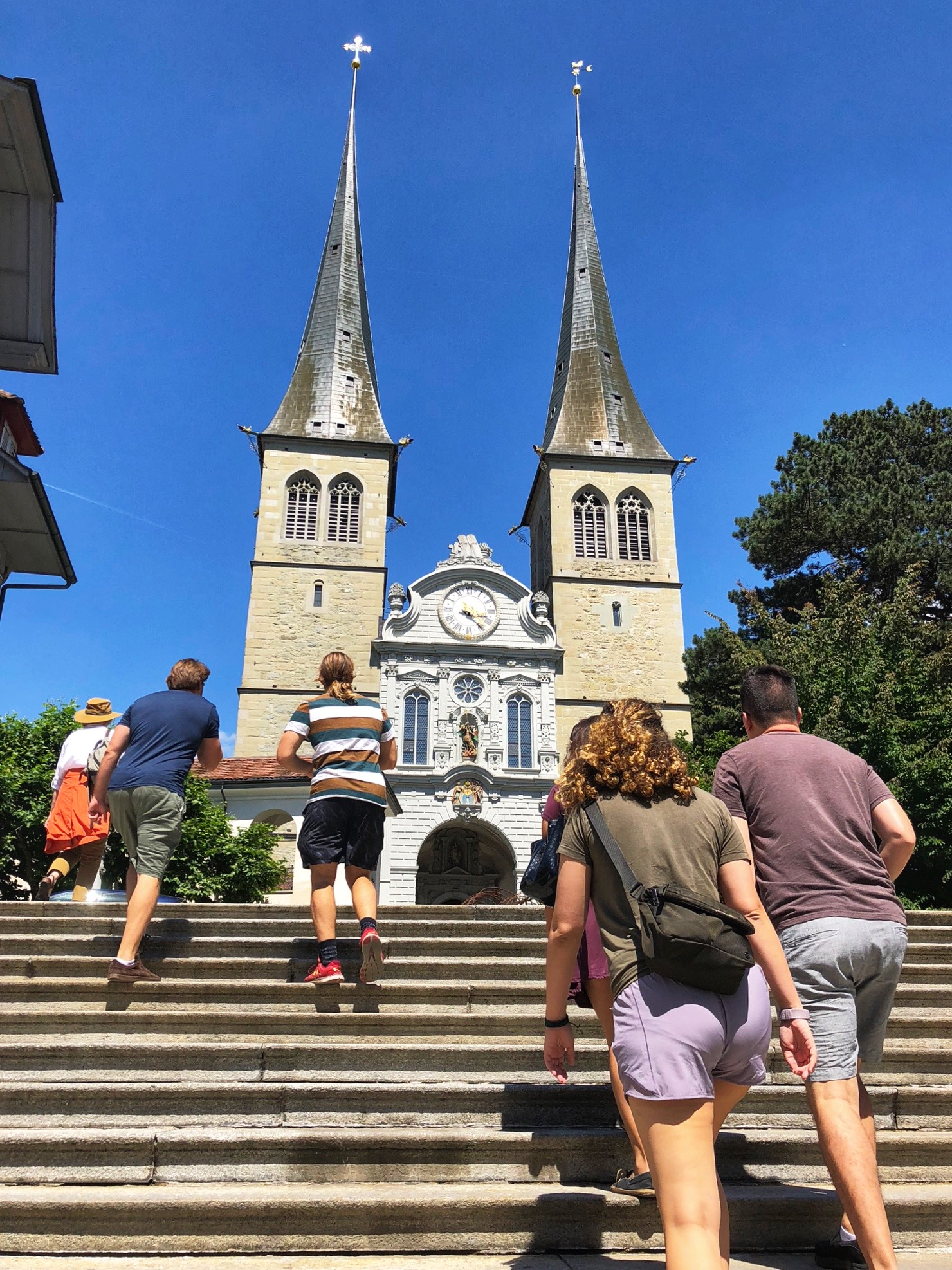 Walking up the steps to the Hofkirche in Lucerne.