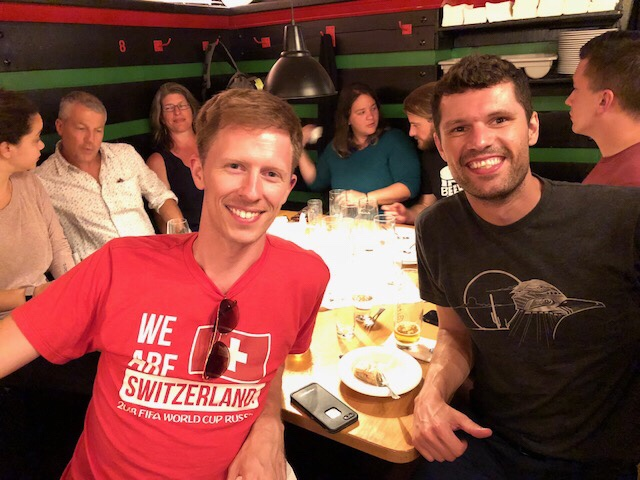 Scott and Marcus loved their wiener schnitzels! Karolers featured in the background. Picture by Katherine Crosier.
