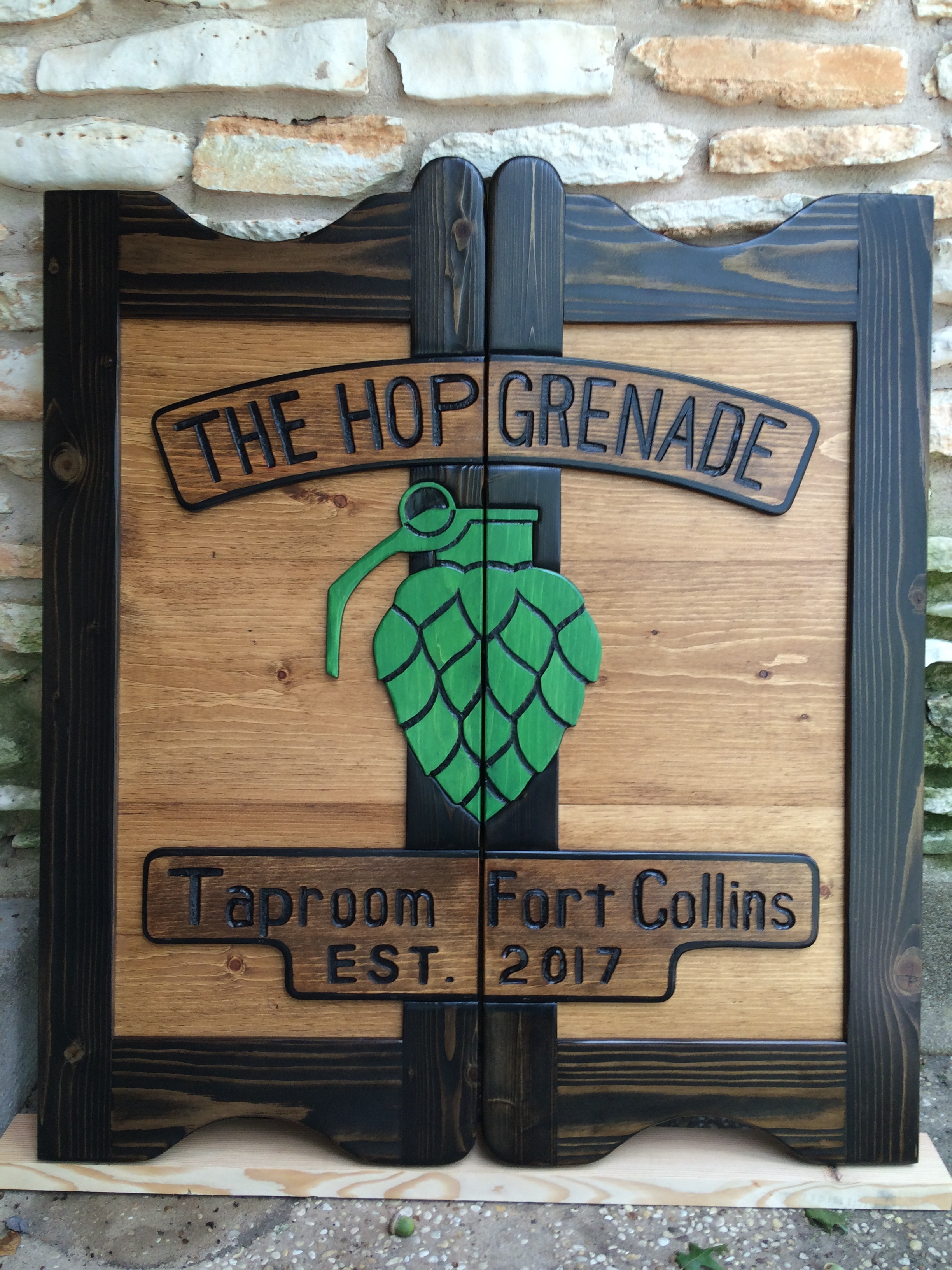 The Hop Grenade western saloon door with company logo