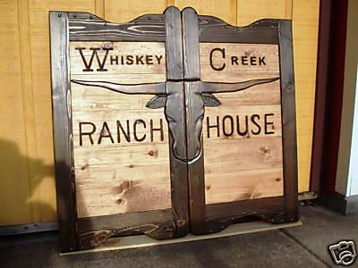 Whiskey Creek Ranch House western saloon doors with Texas longhorn