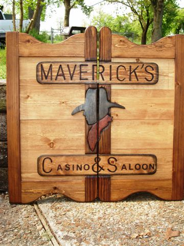 Maverick's Casino & Saloon western saloon door with cowboy and two-tone stain