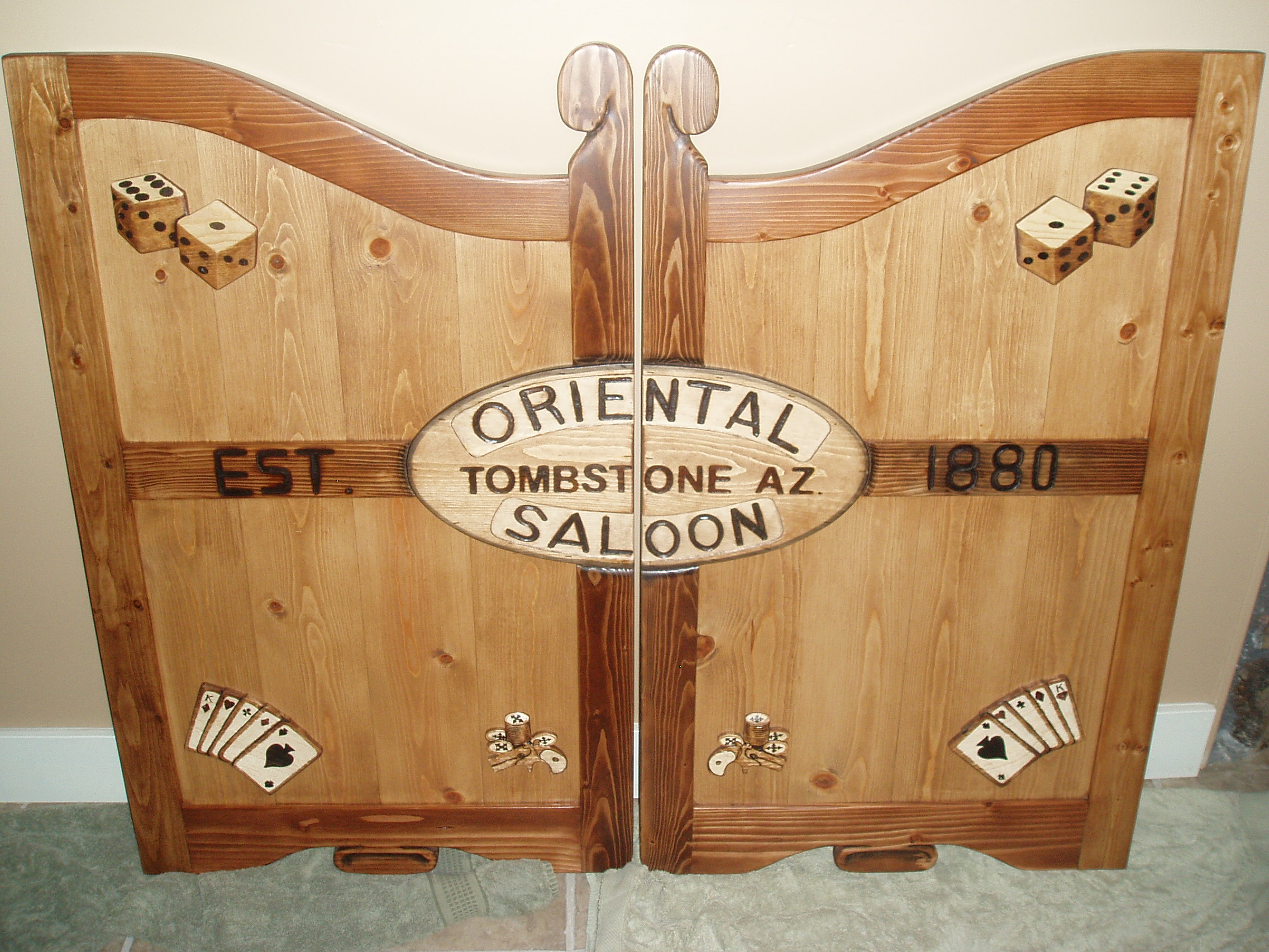 Oriental Saloon Tombstone, AZ western saloon door with dice and cards