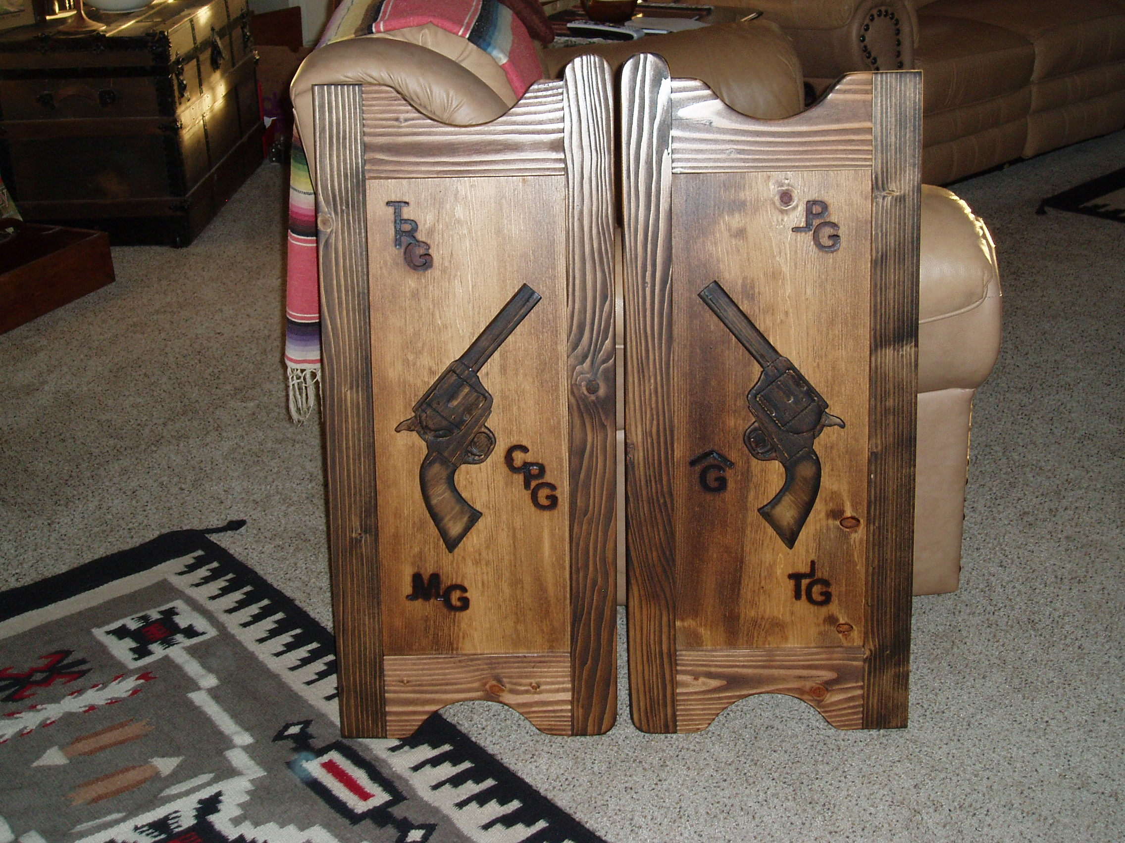 Western saloon doors with pistols and cattle brands