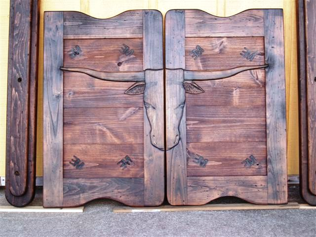 Western saloon doors with texas long horns and brands