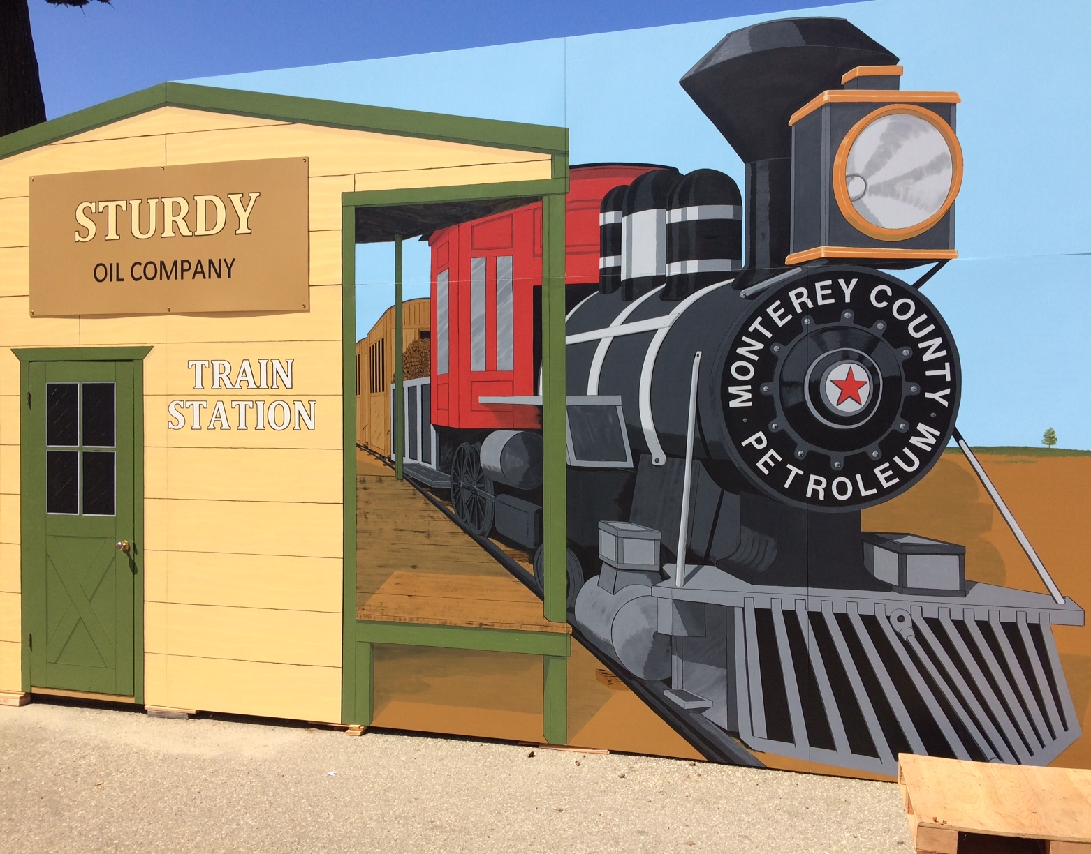 Western mural with train