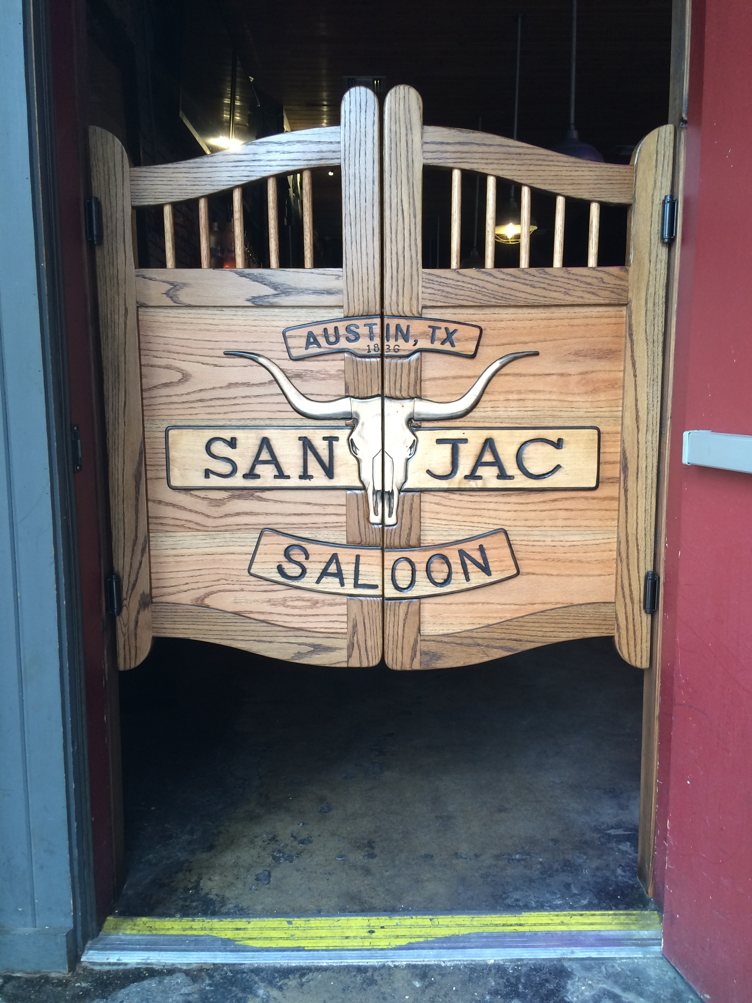 Western swinging saloon door with longhorn skull - San Jac Saloon, Austin, TX