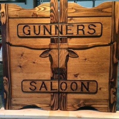 Gunners Saloon western saloon door with Texas longhorn and custom lettering