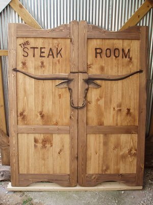 Steak room oversize western saloon doors with Texas longhorn