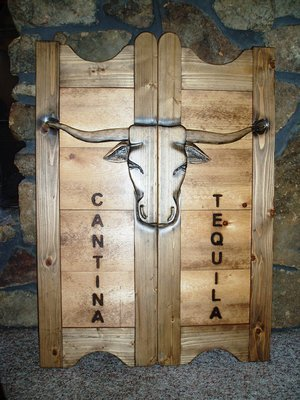 Cantina Tequila tall western saloon doors with Texas longhorns