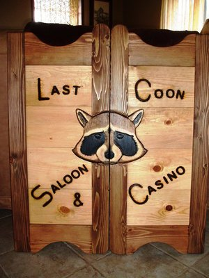 Last Coon Saloon & Casino western saloon door with raccoon