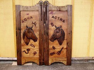 Western saloon doors with horses and cattle brands