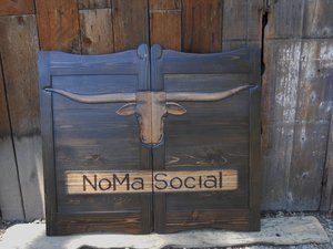 NoMa Social House western saloon door with dark stain and Texas longhorn