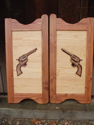 Western saloon doors with six shooter pistols