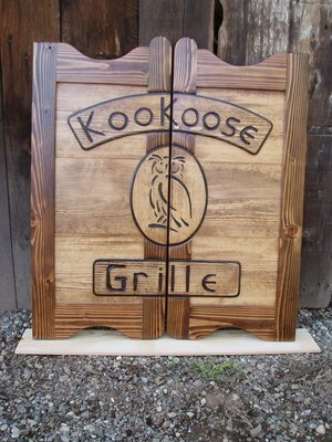 KooKoose Grille western saloon door with logo