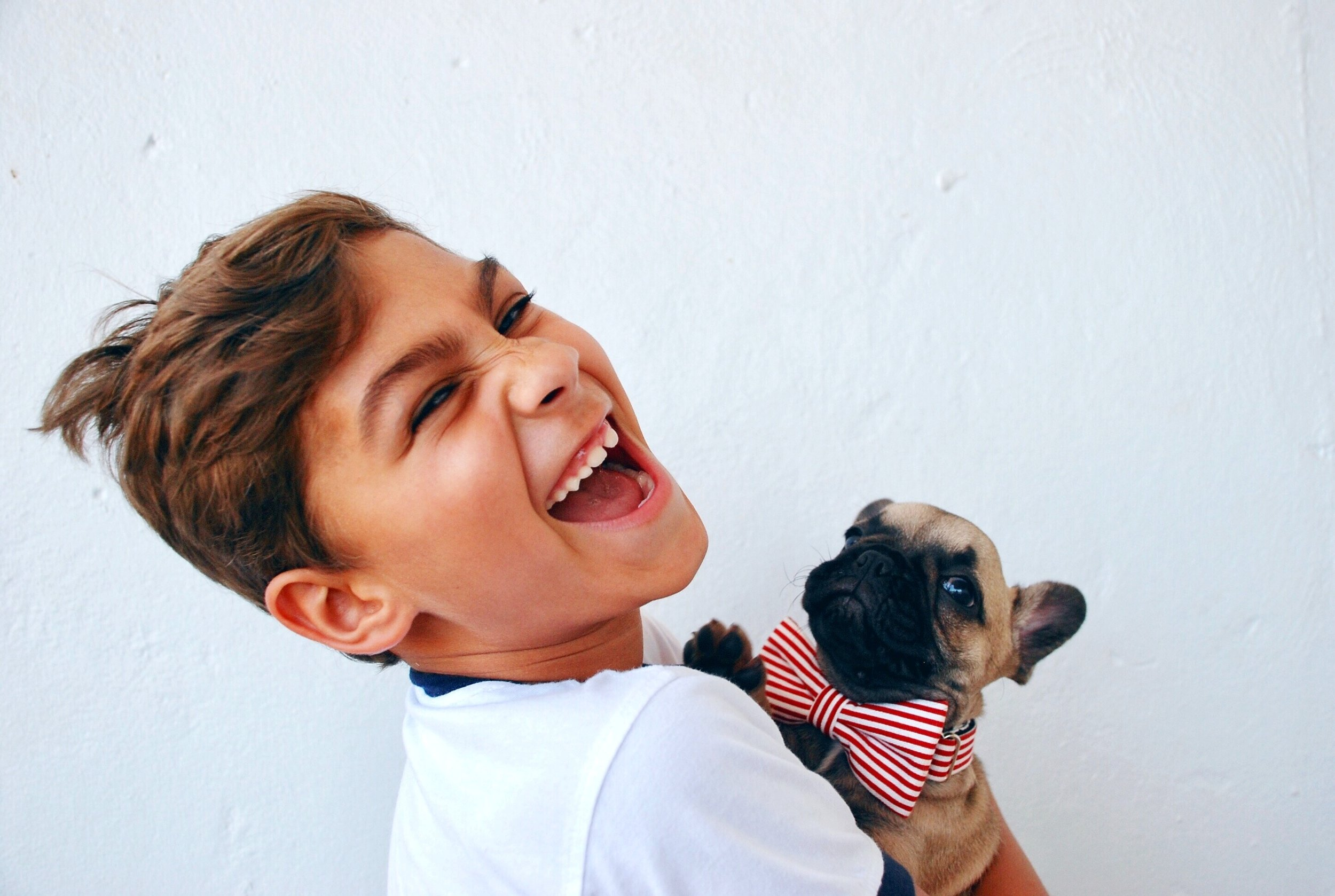 The boy seems happy but the dog looks worried.