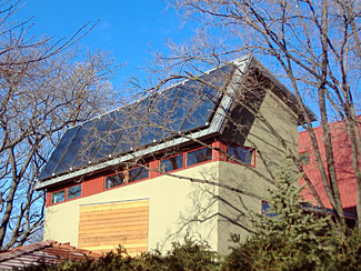 Solar Thermal Residence - This project demonstrates how solar thermal heating can be integrated into the design of the structure. This renovation project included additions to the original 1941 structure. The owners established initial goals with the Locus Architecture team to retain some of the original structure. Together, they set project goals for utilizing an attractive design to incorporate energy efficiency, renewable energy, and durability into one. The renewable energy system collects the sun's energy to provide domestic hot water and space heating. The house was restructured to increase the square footage while transforming it into a high-performance building.