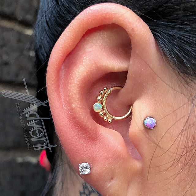 Daith piercing featuring Solid 14k Yellow Gold housing Genuine AAA Grade White Opal from @bvla! Hate to watch it go🤦🏼♂️, but we love to watch it leave! 😻