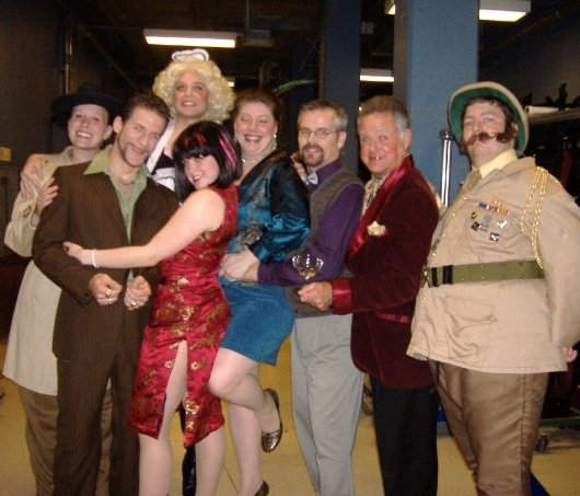 """CLUE - The Muscical - What I really liked about Clue was that our show was different from each of the others that will run each night until Saturday. The play turned out one of 216 possible ways: Miss Scarlett killed Mr. Boddy with the wrench in the conservatory.No one slights Miss Scarlett with a ring beset with cubic zirconia and then dumps her for Mrs. Peacock, who confessed to retaining Joan Rivers's plastic surgeon, and gets away with it.The soon-to-be-offed Mr. Boddy was in charge of the show from the start, which I thought was pretty interesting since he was dead for a good part of it. He explained the rules of the game at the beginning of the show, thank goodness. I'd never played the board game (don't gasp – it's been done).One person said """"I want this guy to hang out at my house and just talk about stuff. Great voice, great delivery…"""" Read the full article by clicking the link below."""