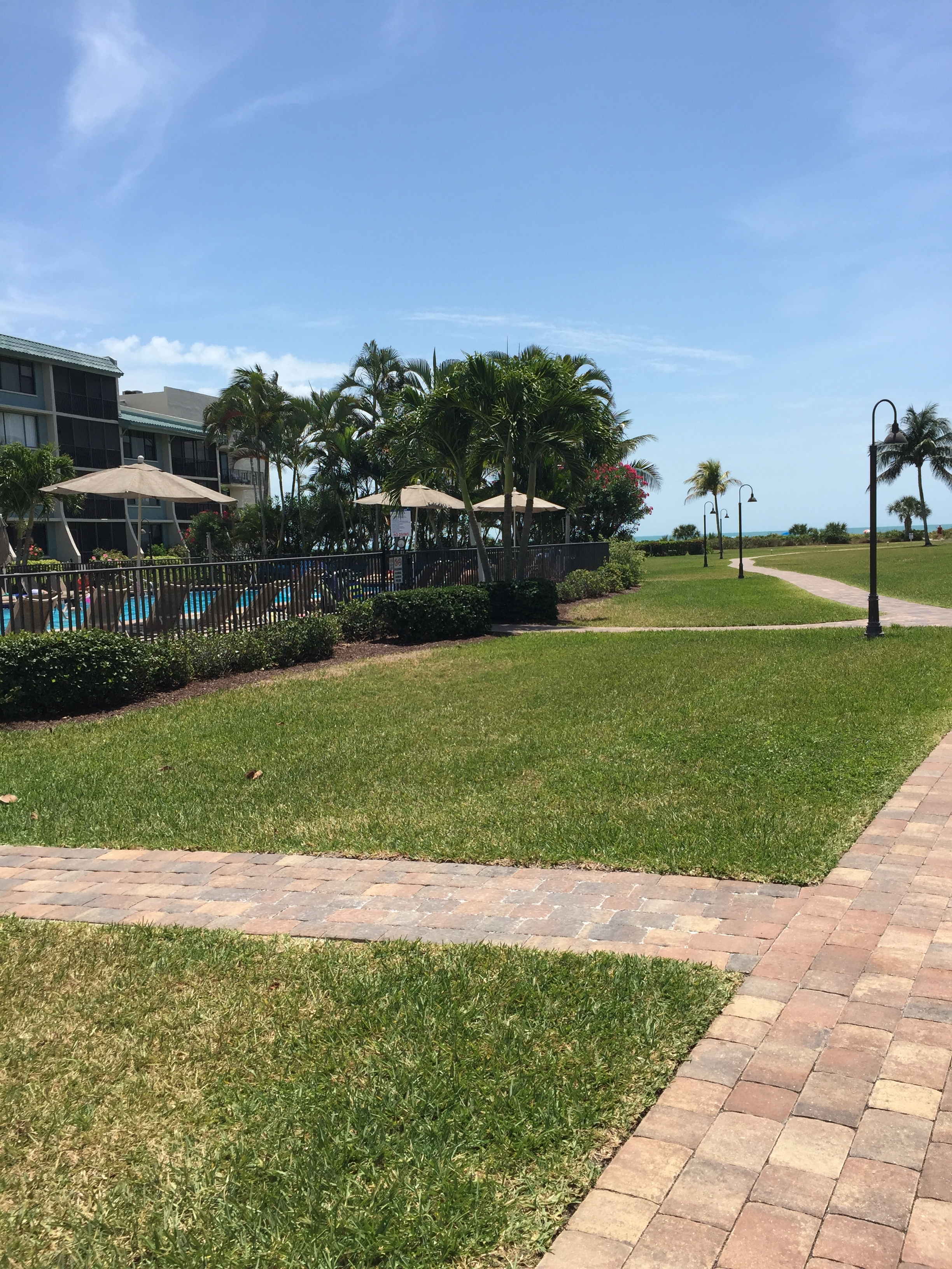 Courtyard path to swimming pool and beach.JPG