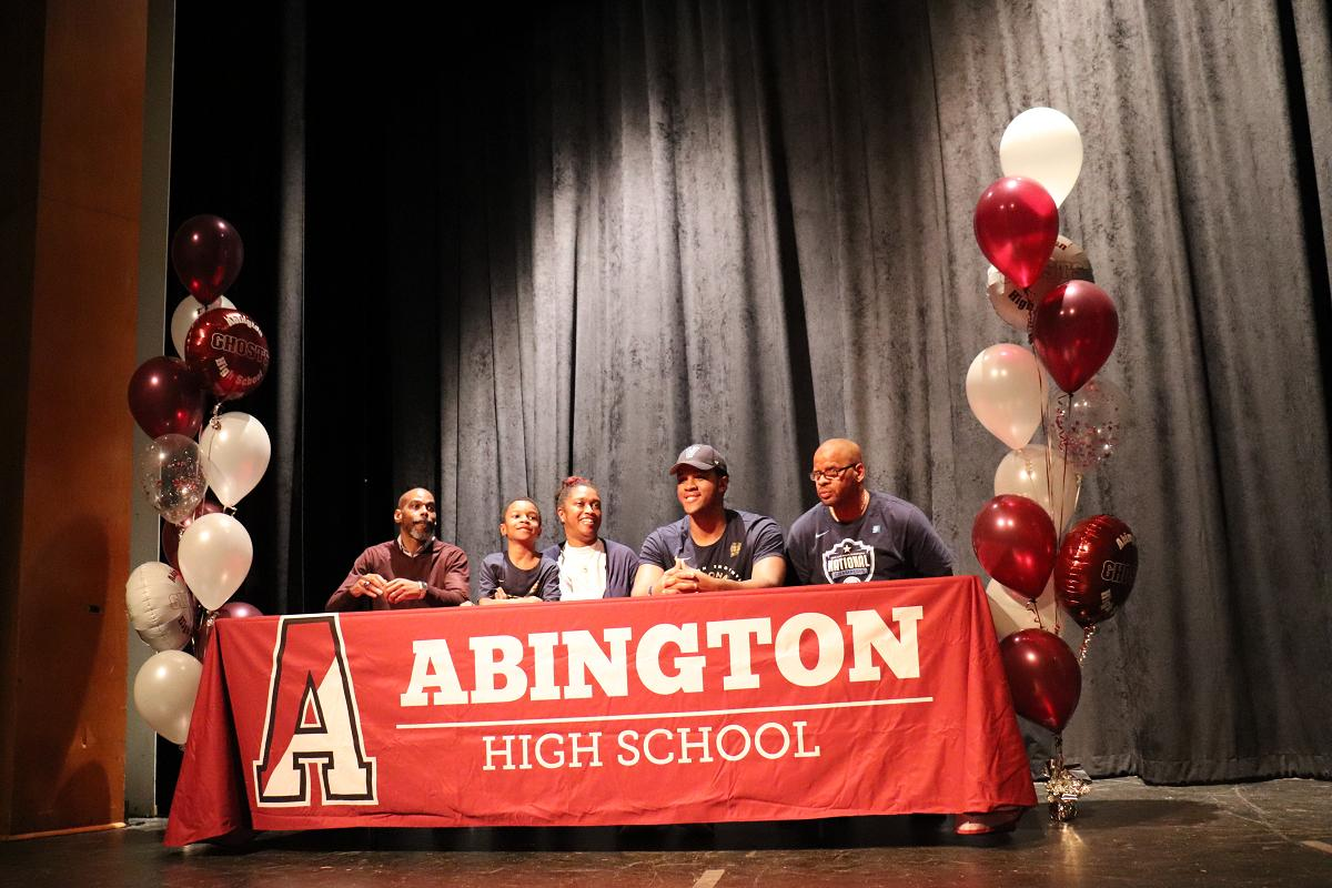 Eric Dixon with little brother Charles, parents and Coach Charles Grasty.JPG