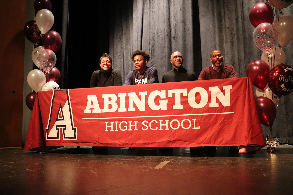 Lucas Monroe with parents and Coach Charles Grasty.JPG