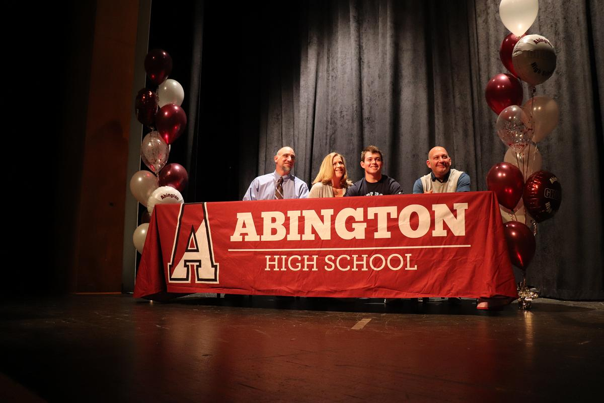 Griffin Wittenberg and parents with Coach Jon Morrissette.JPG